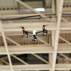 Drone flying in an industrial factory indoor